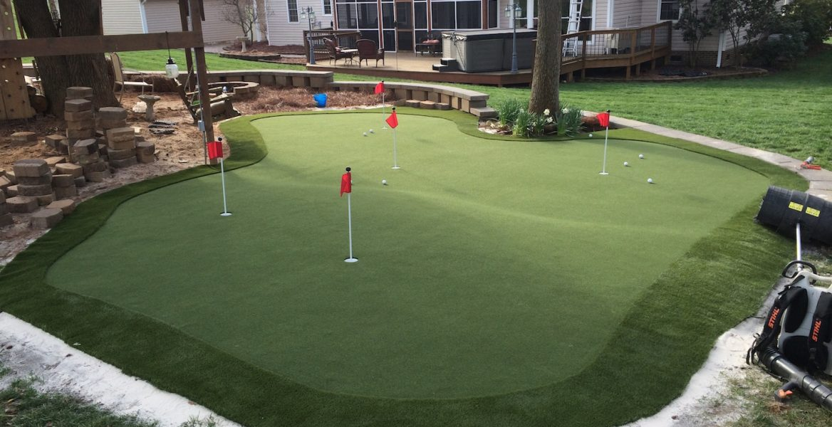 Large backyard artificial putting green in North Carolina