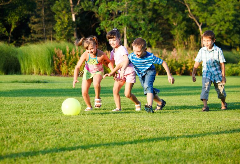 Children playing soccer on artificial grass in North Carolina