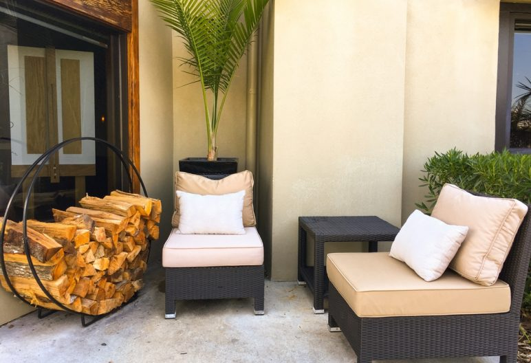 Lounge chairs and firewood accent artificial grass in South Carolina