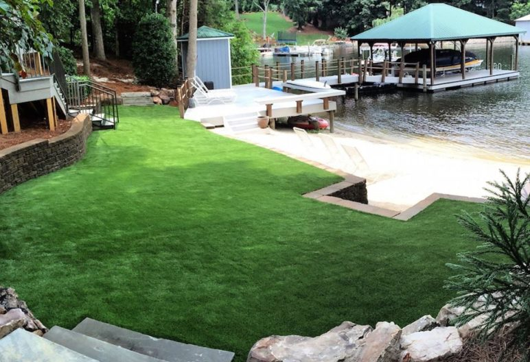 Synthetic grass backyard on a lake