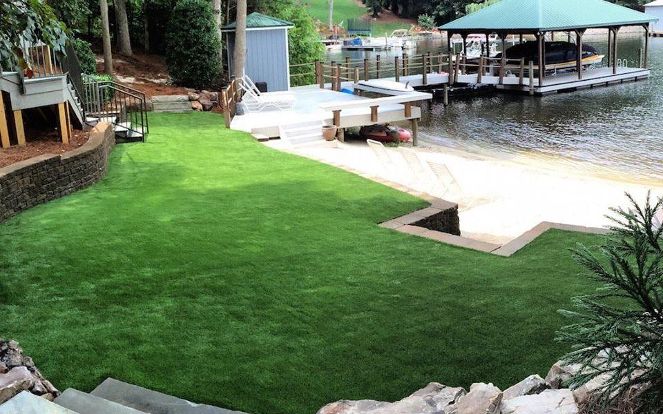 Synthetic grass backyard on a lake