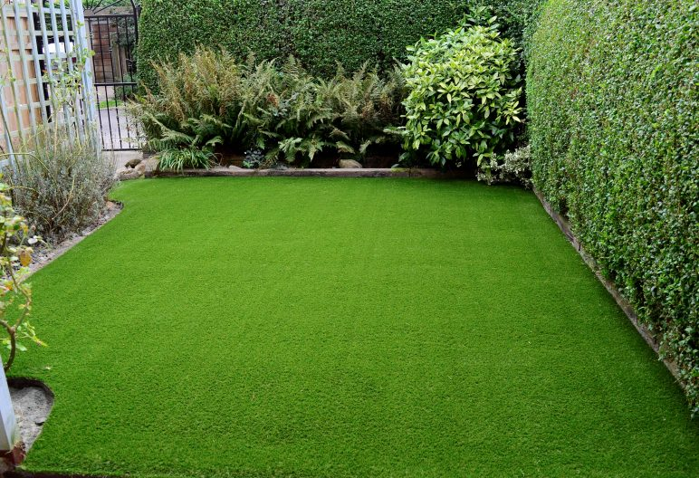 Artificial grass lawn with foliage